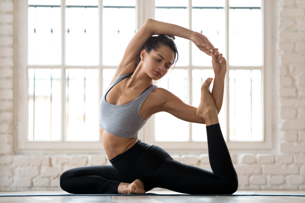 Young sporty attractive woman practicing yoga