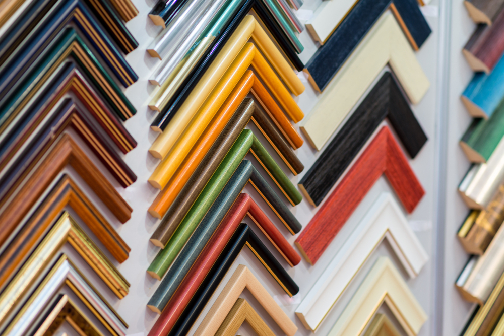 Frame options on the wall of a Frame Shop
